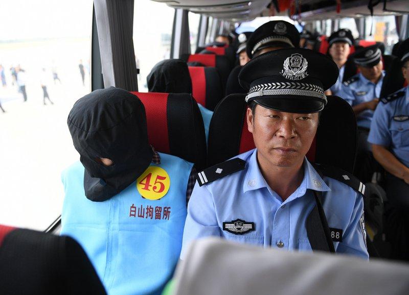 中國打擊電信詐騙 首度從大洋洲押回嫌犯