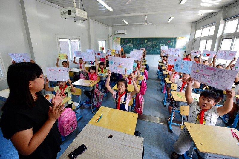 中國擬推新規 路透社:將禁止學生寒暑假與周末補習